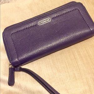 Purple coach zip around wallet /wristlet